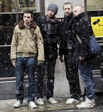Jonny Buckland Photo - UK band Coldplay look in lively spirits as they stand outside BBC Radio studios during a snowy afternoon  The group Chris Martin Jonny Buckland Guy Berryman and Will Champion appeared on BBC 1s Live Lounge where they performed their single Christmas Lights The group will be performing two Crisis Hidden Gig shows with The Choir with No Name before Christmas in Liverpool and Newcastle  The BBC appearance comes on the heels of news that two songs performed by Martins wife Oscar winning actress Gwyneth Paltrow have been shortlisted for the 2011 Best Song Oscar one of which Me and Tennessee was written by Chris London UK 121710