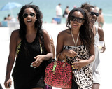 Angela Simmons Photo - Wearing a ruffled bikini with a white top and black bottom daughter of Run-DMC founding member Joseph Simmons Angela Simmons spends the afternoon with a group of friends on South Beach during her birthday weekend Simmons turned 23 on Saturday and spent the weekend celebrating with friends Miami Beach FL 91910