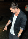 30 Seconds to Mars Photo - Brothers Jared and Shannon Leto of the band 30 Seconds to Mars leave the restaurant Katsuya after dinner The blonde Jared wore a thigh-length leather coat over his black t shirt and jeans as the two waited for their vehicle outside Los Angeles CA 91210