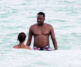 Alicia Etheridge Photo - Singer Bobby Brown takes a dip in the warm Miami Beach ocean with his fiancee Alicia Etheridge  After spending time in the water the couple walked to shore and dried off with beach towels Miami FL 092610