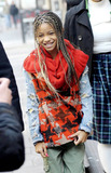 Willow Smith Photo - Pint-sized singer and actress Willow Smith shows off her long braided hair and pink manicured nails and trendy outfit including a houndstooth patterned vest and sparkly shoes as she leaves BBC Radio 1 with a guardian  Willow 10 recently debuted her new single 21st Century Girl on The Oprah Winfrey Show where she also commented that her life is busy but its 50 percent work and 102 percent fun  Willow will soon be going on a European tour with teen pop sensation Justin Bieber London UK 030211