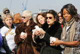 Cheri Lunghi Photo - Jude Kelly Annie Lennox Cheri Lunghi and Bianca Jagger walk side by side with other women carrying signs on Millennium Bridge during the second annual Join me on the Bridge campaign where white doves were released on International Womens Day  Among the women was Dr Helen Pankhurst who said Im honored to be taking part in the Join Me on the Bridge campaign standing strong with women around the world in demanding equality between the sexes as my great-grandmother did 100 years ago referring to Emmeline Pankhurst an English political activist and leader of the British suffragette movement London UK 030811