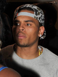 ATL Photo - Singer Chris Brown chats with a fan and flashes the peace sign as he leaves LUX club after partying it up during a scheduled appearance  Brown who back in the summer of 2009 faced assault charges after beating up his ex-girlfriend pop singer Rihanna was joined by a carload full of girls presumably picked up at the club  A medley of ladies packed in to the car seats and in to the trunk  The Deuces singer posted to his Twitter account yesterday Come party wit me LUX Miami tonight  Club Obsessions ATL tomorrownot performing but we shutting it down Miami FL 090310