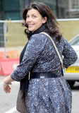 Alan Sugar Photo - British TV presenter Kirstie Allsopp appears happy as she leaves BBC Radio studios a week after Lord Alan Sugar British entrepreneur and star of the reality TV program The Apprentice called her a lying cow on Twitter London UK 102810