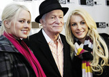 Playboy Magazine Photo - Hugh Hefner and girlfriends Anna Berglund (L) and Crystal Harris (R) attend a screening of Hugh Hefner Playboy Activist and Rebel a documentary about the Playboy magazine founder directed by Oscar winning documentarian Brigitte Bermanheld held at the Gene Siskel Film Center Chicago IL 102910