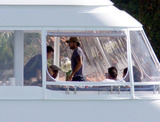 Tony Parker Photo - The day after Eva Longoria and rumored new love Spanish singer Eduardo Cruz were spotted kissing aboard a luxury yacht the reported new couple were seen once again on deck this afternoon Eva and Eduardo sat side by side as they lunched with friends on the deck on the luxury vessel the same boat that Eva was seen on last year with her then husband Tony Parker during happier times Miami FL 2711 Miami FL 262011