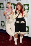 Sia Furler Photo - Australian Singer Sia Furler and Kate Pierson of the B-52s Arriving at Bette Midlers New York Restoration Projects Annual Hulaween Gala at the Waldorf-astoria in New York City on 10-30-2009 Photo by Henry Mcgee-Globe Photos Inc 2009