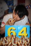 Takeru Kobayashi Photo - Former Nathans Famous Hot Dog Eating ChampionTakeru Kobayashi at the official weigh-in ceremony for the 94th Annual Nathans Famous Fourth of July International Hot Dog-Eating Contest at Macys Herald Square on July 2 2009 in New York City
