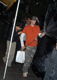 Demi Moore Photo - Hollywoods new hottest couple Demi Moore and Ashton Kutcher departing from a Downtown restaurant New York June 21 2003