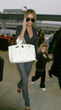 Brooklyn Beckham Photo - Fashion icon and former spice girl Victoria Beckham shephards her son Romeo into JFK Airport enroute to LA