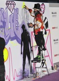 Alec Monopoly Photo - Graffiti artist Alec Monopoly at the world premiere of Justin Biebers Believe at the Regal Cinemas LA LiveDecember 18 2013  Los Angeles CAPicture Paul Smith  Featureflash