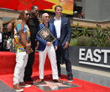 Tony Robbins Photo - LOS ANGELES CA July 15 2016 Singer Pitbull (Armando Christian Perez) with Lil Jon Luther Campbell  motivational speaker Tony Robbins on Hollywood Blvd where Pitbull was honored with the 2584th star on the Hollywood Walk of FamePicture Paul Smith  Featureflash