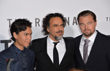 Alejandro GInarritu Photo - Director Alejandro G Iarritu (centre) with actors Forrest Goodluck (left)  Leonardo DiCaprio at the Los Angeles premiere of their movie The Revenant at the TCL Chinese Theatre Hollywood December 16 2015  Los Angeles CAPicture Paul Smith  Featureflash