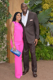 Earvin Magic Johnson Photo - LOS ANGELES CA June 27 2016 Basketball star Earvin Magic Johnson  wife Cookie Johnson at the world premiere of The Legend of Tarzan at the Dolby Theatre HollywoodPicture Paul Smith  Featureflash