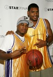Allan Houston Photo - Ne-Yo (L) and Allan Houston arrive to the fourth annual charity shootout hosted by iStar Foundation at Madison Square Garden on July 10 2006 in New York City
