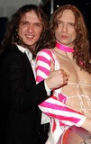 Justin Hawkins Photo - London  Justin Hawkins frontman for the group The Darkness appears with his wax-work double at Madame Tussauds17 March 2005Ali KadinskyLandmark Media