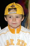 Brooklyn Beckham Photo - London Brooklyn Beckham (with hat) who is the son of Victoria Posh Spice  Beckham  and husband international football player David Beckham   at the London premiere of  Scooby-Doo 2 Monsters Unleashed    26th March 2004 PICTURES BY RAOUL TREZARILANDMARK MEDIA LMK