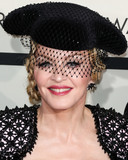 Grammy Awards Photo - (FILE) Madonna Says She Has Coronavirus COVID-19 Antibodies LOS ANGELES CALIFORNIA USA - FEBRUARY 08 Singer Madonna wearing Givenchy Haute Couture by Riccardo Tisci arrives at the 57th Annual GRAMMY Awards on February 8 2015 in Los Angeles California United States (Photo by Xavier CollinImage Press Agency)