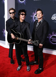 Green Day Photo - LOS ANGELES CALIFORNIA USA - NOVEMBER 24 Mike Dirnt Billie Joe Armstrong and Tre Cool of Green Day arrive at the 2019 American Music Awards held at Microsoft Theatre LA Live on November 24 2019 in Los Angeles California United States (Photo by Xavier CollinImage Press Agency)
