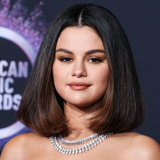 Selena Gomez Photo - (FILE) Selena Gomez Makes Big Donation to Cedars-Sinai Amid Coronavirus COVID-19 Pandemic Health Crisis Selena Gomez is making a major donation to Cedars-Sinai LOS ANGELES CALIFORNIA USA - NOVEMBER 24 Singer Selena Gomez wearing a Versace dress and shoes with Roberto Coin jewelry arrives at the 2019 American Music Awards held at Microsoft Theatre LA Live on November 24 2019 in Los Angeles California United States (Photo by Xavier CollinImage Press Agency)