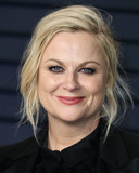 Alberta Ferretti Photo - BEVERLY HILLS LOS ANGELES CA USA - FEBRUARY 24 Actress Amy Poehler wearing a custom Alberta Ferretti tux Steve Madden shoes Lorraine Schwartz jewelry and Tyler Ellis bag arrives at the 2019 Vanity Fair Oscar Party held at the Wallis Annenberg Center for the Performing Arts on February 24 2019 in Beverly Hills Los Angeles California United States (Photo by Xavier CollinImage Press Agency)
