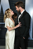 Cake Photo - (FILE) Miley Cyrus and Liam Hemsworth Appear to Be Married Miley Cyrus and Liam Hemsworth appeared to have tied the knot six years after getting engaged Miley Cyrus and Liam Hemsworth are believed to have tied the knot in a low-key ceremony at home The singer 26 and actor 28 who got engaged six years ago have been seen cutting their wedding cake in a series of photos on social media BEVERLY HILLS LOS ANGELES CA USA - MARCH 04 Singer Miley Cyrus and boyfriendactor Liam Hemsworth arrive at the 2018 Vanity Fair Oscar Party held at the Wallis Annenberg Center for the Performing Arts on March 4 2018 in Beverly Hills Los Angeles California United States (Photo by Xavier CollinImage Press Agency)