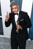 JoJo Photo - BEVERLY HILLS LOS ANGELES CALIFORNIA USA - FEBRUARY 09 Director Taika Waititi winner of the Adapted Screenplay award for Jojo Rabbit arrives at the 2020 Vanity Fair Oscar Party held at the Wallis Annenberg Center for the Performing Arts on February 9 2020 in Beverly Hills Los Angeles California United States (Photo by Xavier CollinImage Press Agency)
