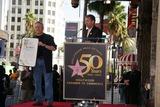 Alan Menken Photo - Composer Alan Menken Honored with Star on the Hollywood Walk of Fame El Capitan Theatre Hollywood CA 11102010 Alan Menken and Leron Gubler Photo Clinton H Wallace-photomundo-Globe Photos Inc 2010