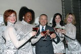 The Radio City Rockettes Photo - I7189CHWTHE  RADIO CITY ROCKETTES HOST A HOLIDAY CELEBRATION AT THE W NEW YORK-TIMES  SQUARE ROCKETTE COSTUMES BY DESIGNER BOB MACKIE WILL ADORN THE LIVING ROOM AREAS AS GUESTS TOAST  THEIR FESTIVE ROCKETTE-TINIS A NEW HOLIDAY BEVERAGE CREATED BY W AND THE RADIO CITY ROCKETTES 11212002PHOTO BY CLINTON W WALLACEIPOLGLOBE PHOTOS INC  2002THE RADIO CITY ROCKETTES POSE WITH SETH ABRAHAM PRESIDENT OF MADISON SQUARE GARDEN