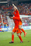 Arjen Robben Photo - Nark Van Bommel  Arjen Robben Cellebrate Win Holland V Ivory Coast World Cup Soccer 06-16-2006 Photo by Allstar-Globe Photos