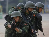 ARMED POLICE Photo - Apr 10 2008 Beijing China the Armed Police Who Will Work in the Olympic Studaium Also Known As Birds Nest During the Olympic Games Have a Special Training K59099 Atmosphere Photo by Top Photo-Globe Photos Inc