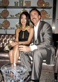Alice Kim Photo - Versace Boutique Re-opening Party in Their Vip Room at 647 5th Ave New Yirk City 02-07-06 Photo by Jbarrett-allen-Globe Photoinc Nicolas Cage and Wife Alice Kim