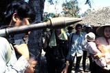 Jeff Taylor Photo - Vietcong Soldeier Carries a B-40 Rocket Grenade Anti-tank Weapon Through Nlf Village in Mekon Dela South Vietnam Photo by Jeff TaylorGlobe Photos