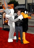 Joe Dante Photo - Looney Tunes Back in Action World Premiere at Graumans Chinese Theatre Hollywood CA 1192003 Photo by Fitzroy BarrettGlobe Photos Inc2003 Director Joe Dante with Bugs Bunny and Daffy Duck