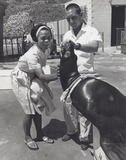 Eartha Kitt Photo - Eartha Kitt with Trainer Harley Toney and the Sea Lion Cy at Marineland of the Pacific Photo by Smp-Globe Photos Inc
