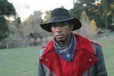 Antwon Tanner Photo - EXCLUSIVEANTWON TANNER  -FILMING OF BROTHAS IN ARMS AT THE SABLE RANCH IN NEWHALL CA -THIS URBAN WESTERN IS WRITTEN AND DIRECTED BY JEAN CLAUDE LAMARRE AND STARRING DAVID CARRADINE KENYA MOORE AND KURUPT -12-17-2004 -PHOTO BY NINA PROMMERGLOBE PHOTOS INC2004K40927NP