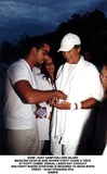 Hugh Edwards Photo - 499 - East Hamptonlong Island Magician David Blaine Shows Chevy Chase a Trick Atpuffy Combs Annual Labor Day Cookout and Party Where Everyone Is Required to Wear White Credit  Hugh Edwards IpolGlobe Photos Inc