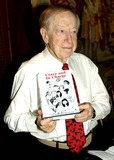 Abe Hirschfeld Photo - Abe Hirschfeld Signs Copies of His New Book Crazy and in Charge at the 42nd Street Public Library  New York City 11182003 Photo Bybarry TalesnickipolGlobe Photos Inc 2003