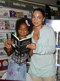 Afeni Shakur Photo - Jasmine Guy Signs Her New Book Afeni Shakur Evolution of a Revolutionary Waldenbooks Baldwin Hills CA (051504) Photo by Milan RybaGlobe Photos Inc2004 Jasmine Guy and Daughter Imani