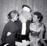 Rock Hudson Photo - Rock Hudson As Santa at Hollywood Womens Press Club with Janet Leigh Deborah Kerr Photo Globe Photos Inc