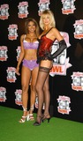 Traci Bingham Photo - - Angie Everhart Nikki Ziering and Traci Bingham Unveils Plans For Lingerie Bowl 2004 - Quixote Studios West Hollywood CA - 06252003 - Photo by Jonathan Friolo  Globe Photos Inc 2003 - Traci Bingham and Kylie Bax