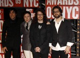 Andy Hurley Photo - Musicians Pete Wentz Patrick Stump Andy Hurley and Joe Trohman of Fall Out Boy Arrive at the Mtv Video Music Awards at Radio City Music Hall in New York USA on September 13th 2009 Photo Alec Michael-Globe Photos Inc 2009